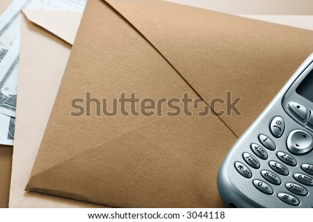 Envelope, mobile phone, dollars-conditions of the modern businessman - stock photo