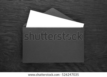 envelope on a black wooden table