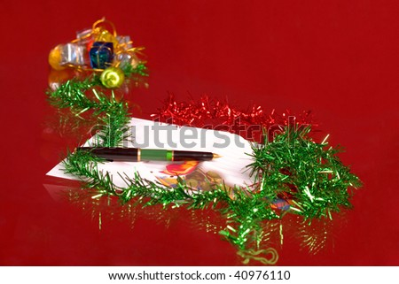 Envelope, pen and ornament for Christmas - stock photo