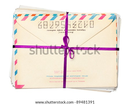 envelope stack crossed by ribbon with bow - stock photo