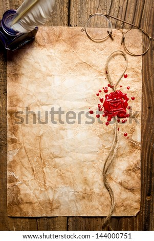 Envelope symbol imprinted in red sealing wax - stock photo