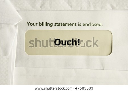 "Envelope with billing statement and ""Ouch!"" in cellophane window - stock photo"