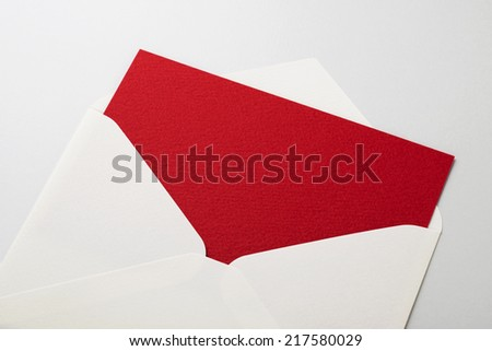 Envelope with blank red paper on white