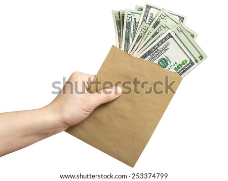 Envelope with dollars in a hand - stock photo