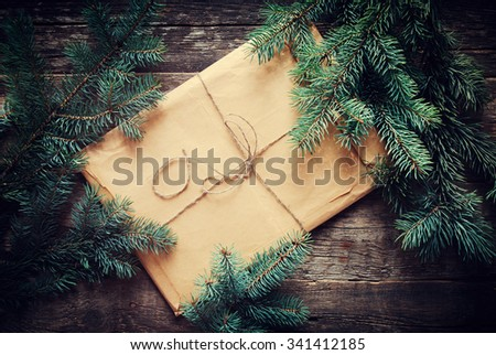 Envelope with Fir-tree Branches on a Wooden Background. Vintage Letter with Cord - stock photo