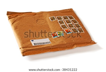 envelope with many colorful stamps - stock photo