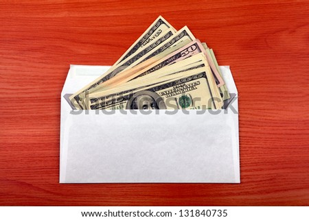 Envelope With Money lying on the table - stock photo