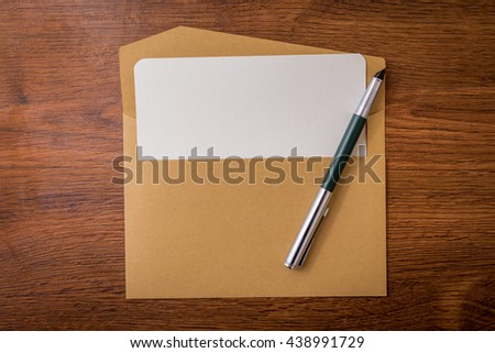 Envelope with pen