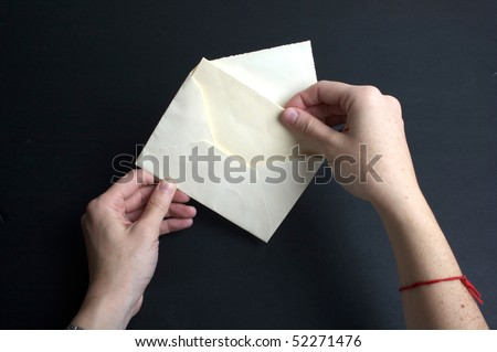 Envelope with white paper - Invitation and envelope - stock photo
