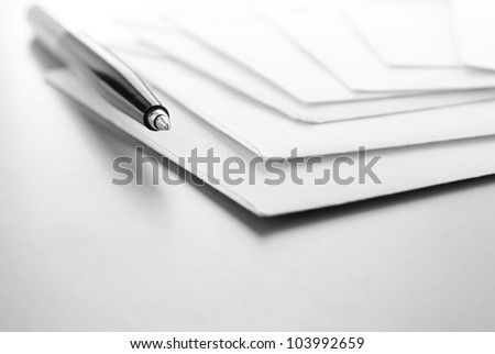 envelopes and ball pen on a table and a place for your text - stock photo