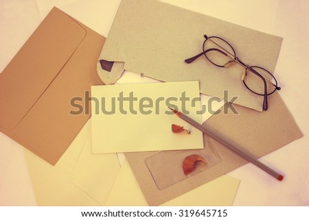 Envelopes with Glasses and Pen