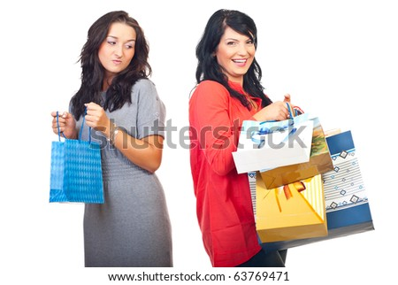 Envious woman on her friend with many shopping bags isolated on white background - stock photo