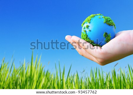 Environment and ecology concept,earth in hand - stock photo