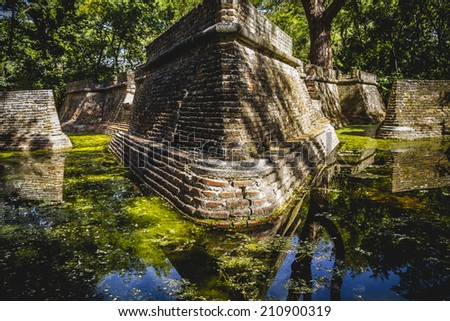 environment, building in ruins on a green swamp with water - stock photo