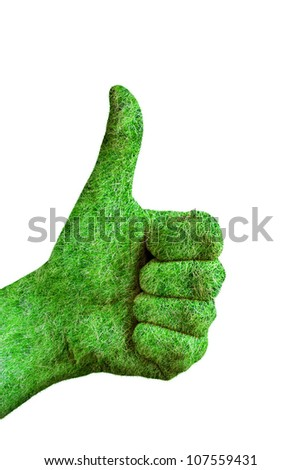 Environment concept - human hand with thumb up covered in grass isolated on white background - stock photo