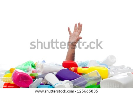 Environment concept with human hand reaching out from beneath plastic recipients - stock photo