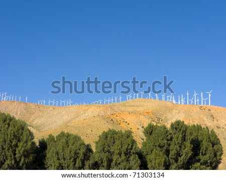 Environment friendly electric power windmills on top of mountains, Palm Springs, Coachella Valley, CA - stock photo