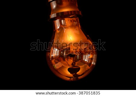 Environment reflections in the glass of the electric bulb - clipping path included. Isolated on black - stock photo