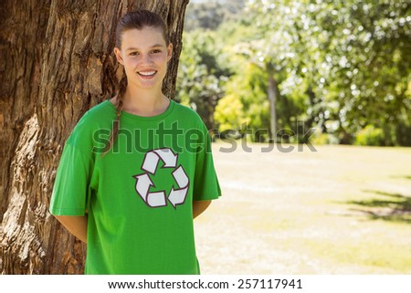 Environmental activist smiling at camera in the park on a sunny day - stock photo