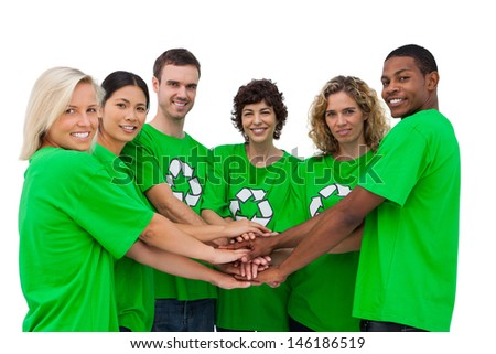 Environmental activists putting their hands together on white background - stock photo