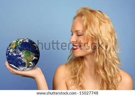 Environmental Concept Woman Holding Earth in the Palm of Her Hand - stock photo