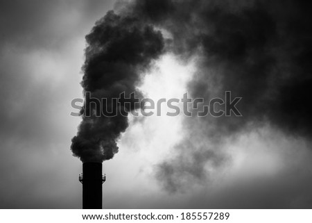 Environmental Damage: Air Pollution. The black smoke of the pipe. - stock photo