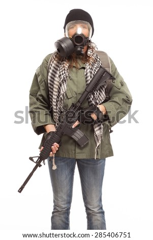 Environmental disaster. Post apocalyptic female survivor wearing her gas mask while holding a rifle on white background. - stock photo