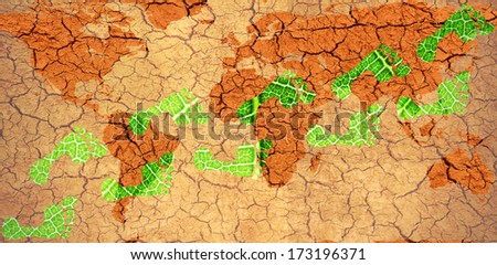 Environmental Footprints on a Map of the World on dry cracked mud- original image of Earth from NASA