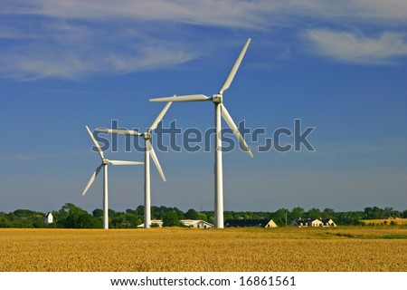 Environmental friendly alternative energy by wind turbines - stock photo