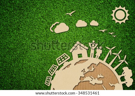 Environmental green energy concept illustration with cardboard cut out on grass. - stock photo