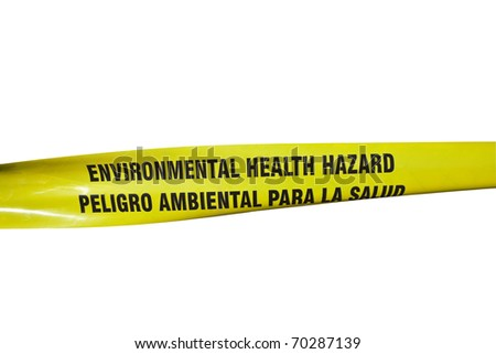 Environmental Health Hazard warning tape on a chain link fence. - stock photo