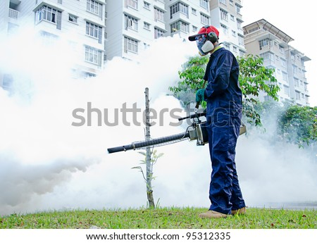 Environmental health workers are fogging for dengue control - stock photo