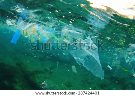 Environmental problem of plastic rubbish pollution in ocean - stock photo