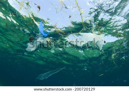 Environmental problem: Plastic bag pollution in ocean - stock photo
