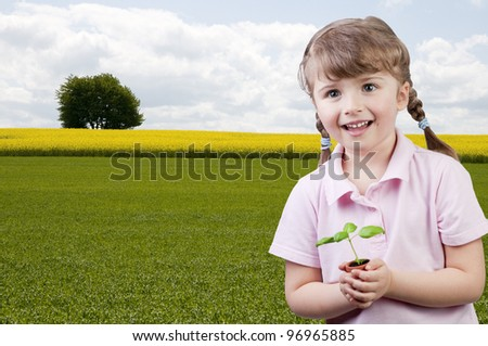 Environmental protection - lovely girl with seedling  (space for text) - stock photo