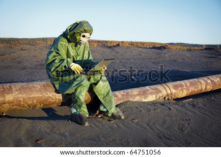 Environmental scientist working in the zone of ecological disaster - stock photo