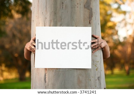 Environmentalist protester holding a blank sign ready for any message or statement - stock photo