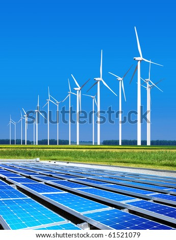 environmentally benign solar panels and wind turbines generating electricity - stock photo