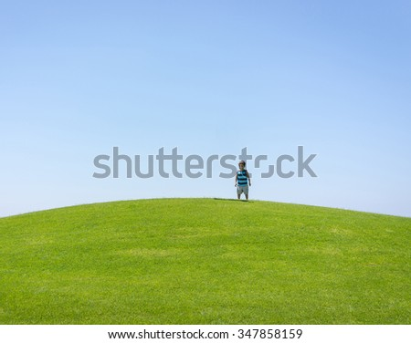 Enyojing on beautiful grass meadow