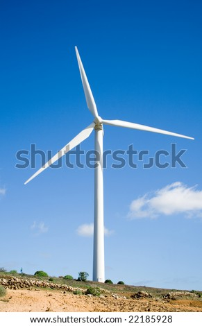 eolic generator in a wind farm - stock photo