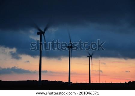 Eolic park at sunset - stock photo