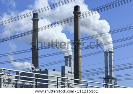 EON power plant in Rotterdam with two coal-fired units of 550 MW operating according conventional steam cycle with single reheating and condensation. - stock photo