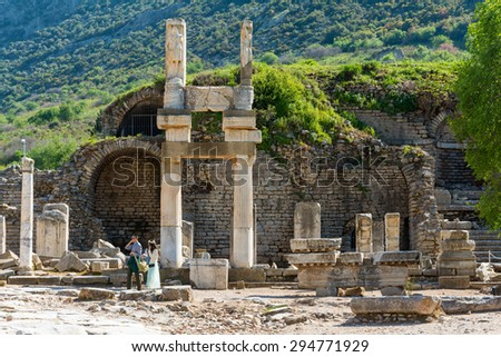 EPHESUS, TURKEY - APRIL 13 :  Tourists in Ephesus Turkey on April 13, 2015. Ephesus contains the ancient largest collection of Roman ruins in the eastern Mediterranean - stock photo