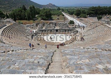 EPHESUS, TURKEY - AUGUST 10, 2015: Tourists visit theatre in the ancient city of Ephesus, located in southwest Turkey.  - stock photo