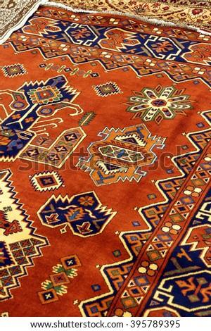 EPHESUS, TURKEY - MAY 25, 2014 -  Details of hand woven carpets  in rug store  Ephesus, Turkey - stock photo
