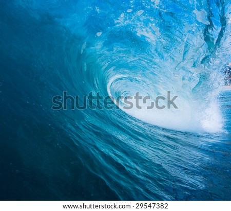 Epic Blue Surfing Wave, View from Inside the Tube - stock photo