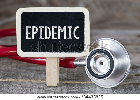 Epidemic and stethoscope. Medecine concept. Blackboard with word Epidemic and stethoscope - stock photo