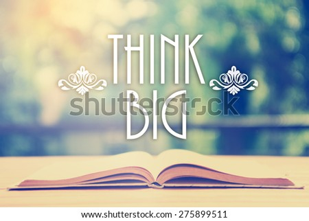 Epigraph over the opened book with elegant ornament - Think Big -  Positive thinking concept - motivating set - stock photo