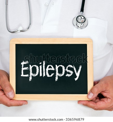 Epilepsy - Doctor holding chalkboard with text - stock photo