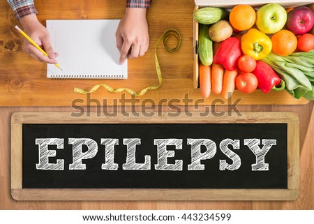 EPILEPSY fresh vegetables and  on a wooden table - stock photo